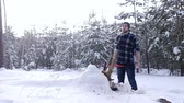 cansado : Tired lumberjack standing in winter forest, steam coming out of his mouth