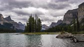 4K Time lapse film video movie Timelapse Clouds Moving Over Spirit Island in Maligne Lake in Jasper Nationalpark Alberta Canada