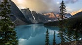 4K Time lapse film video movie of Sunrise Moraine Lake Banff National Park with reflection and golden hour.