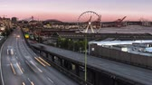 northwest : SEATTLE, WASHINGTON – September 2018: 4K Timelapse movie video film of sun setting on waterfront and marina in downtown Seattle reat Wheel by Elliot Bay.