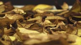 ropogós : Panning left to right  of drying wild mushrooms cut in thins slices.