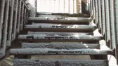 pegajoso : Stairs to the sky. Wooden stairs covered in ice and snow. Houses porch and deck. Stock Footage
