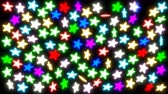 renk : Animated spinning colorful glowing stars against black background. Stok Video