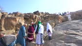 makkah : MECCA, SAUDI ARABIA - CIRCA MARCH, 2015: Muslims at Mount Arafat (or Jabal Rahmah). This is the place where Adam and Eve met after being overthrown from heaven.