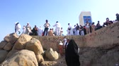 t��o : MECCA, SAUDI ARABIA - CIRCA MARCH, 2015: Muslims at Mount Arafat (or Jabal Rahmah). This is the place where Adam and Eve met after being overthrown from heaven.