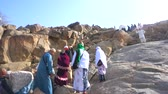 adam : MECCA, SAUDI ARABIA - CIRCA MARCH, 2015: Muslims at Mount Arafat (or Jabal Rahmah). This is the place where Adam and Eve met after being overthrown from heaven.