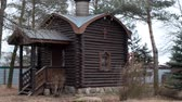 посылка : Russian architecture. Orthodox chopped wooden Church in the village surrounded by pine trees