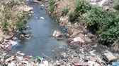 sloppy : Plastic Contamination into Nature. Garbage and bottles floating on water. Environmental pollution. Garbage in the water of river.