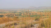 subtropics : Dry, hilly Prairie of Deccan plateau (India, wintertime). views of flat winter valley