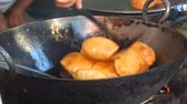 bolinho : Indian doughnuts are cooked in hot oil. Action cook street cafe