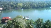 artesanato : tropical river with trawlers in Southeast Asia timelapse. Palm trees, coming in from  ocean ships