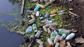 lack of water : plastic pollution of  rivers. old junk heap on  waterfront
