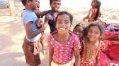 lad : India, Puducherry  - January 30, 2016:  Daily life of India 13. Group of Indian kids different age jumps and plays in front of camera, group leader restores order