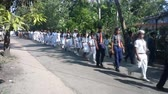 açıklık : India, Kerala - December 27, 2015: procession of Indian students, disciples in white robe