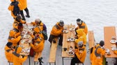 alcançando : Russia, North pole - 15 July 2016: Best Arctic journey. Entertainment tourists.  Partying of  Chinise in North pole