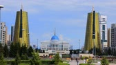 borough : Astana, Kazakhstan - July 17, 2016: Manhattan in steppe. New capital of Kazakhstan city Astana. Golden tower ministries (symbolize the sheaves of wheat). post-Soviet architecture