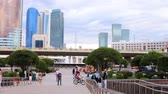 classicism : Astana, Kazakhstan - July 17, 2016: Walk around city with camera on button - exit  to square with skyscrapers, lot of folks. New capital of Kazakhstan city Astana. Stock Footage