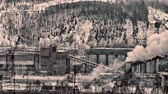 destructive : Old concrete plant (batching plant) in North among hills and coniferous forests in winter