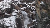 springtide : Snow melting in the Himalayas and temporary wild waterfall. Mountain slopes with mountain scene