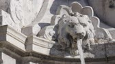 приукрашивание : Fountain-lion. A jet of water gushes from the mouth of a sculpted lion fountain