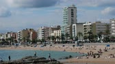 zeepbel : Spain, Lloret de Mar - October 2, 2017: tourist beach with palm trees hotels and vacationers in Mediterranean low season Stockvideo