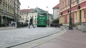 集合的な : Warsaw, Poland - September 7, 2017: Tourist bus rides through the old town and city residents and tourists pedestrians