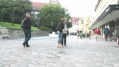 townsfolk : Tallinn, Estonia - September 1, 2017: Old town with cobbled streets, passers-by on the streets