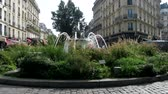 flower bed : Paris, France - 24.09.2017: Classic fountain with two bowls in the middle of a round flower bed