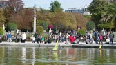 juvenil : Paris, France - 24.09.2017: Parisians let boats in the pond, scale modeling. Many Parisians vacationers