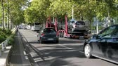 cargo container : Paris, France - 24.09.2017: truck for transportation of cars (haulaway) on the city street half-loaded