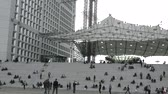 Paris, France - 24.09.2017: Brotherhood square and a lot of visitors from all over the world on a huge area and on the steps to the tesseract arch