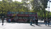 townsfolk : Paris, France - 24.09.2017: Tourist double-Decker bus and tourists in the square. City tour