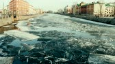 accademia : Springtime, sign of spring. Ice drift (debacle) on the channel in the Northern town of St. Petersburg, Russia Filmati Stock