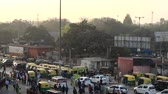 моторизованный : India, new Delhi - March 26, 2018: Station square with transport and passers-by. Top view Стоковые видеозаписи