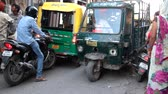 borough : India, Varanasi - March 20, 2018: Traffic jam on a narrow street. Tuk-tuks and motorcycles