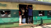 India, new Delhi - March 26, 2018: Departure of the Indian suburban train from the platform. This train has no glass windows and doors Stock mozgókép