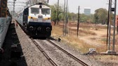 India, new Delhi - March 26, 2018: locomotive runs parallel to passenger train. transport of India by rail Stock mozgókép