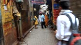 India, Varanasi - March 21, 2018: Narrow shopping streets with many passers-by