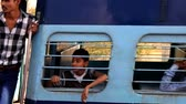 India, Khajuraho - 23 March 2018: passengers of super fast Express train in India rush past platform