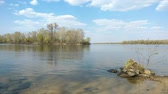 abedul : Day close to the Dnieper river during a quiet spring day. Waves on the water and soft clouds in the sky. Kiev, Ukraine Archivo de Video