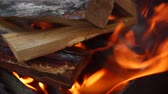 flammable : HD Close up shot moving away from a fire with wood burning logs in fire place