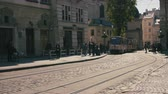 corredor : The close up shot of the road with tracks. The tram is coming from the corner Stock Footage