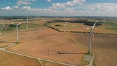 pár : Aerial view of spinning wind turbines