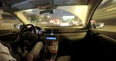 Time lapse footage of driving in the night city traffic. View from the interior of the car. A young man drives a car Стоковые видеозаписи