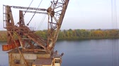 cabine : Aerial footage. The camera rises up the old gantry cranes.