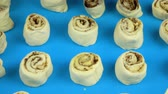 countertop : Slow motion footage. Lubrication egg cinnamon rolls before they come into the oven