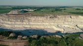 dumper : 4K drone aerial footage. Fly over a mountain stone quarry. Dolly shot Stock Footage