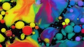 saturado : Amazing multicolored bubbles of paint on the oil surface. Paint in oil. Vídeos