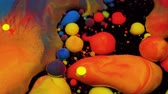 garip : Amazing multicolored bubbles of paint on the oil surface. Paint in oil. Stok Video