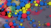 Amazing multicolored bubbles of paint on the oil surface. Paint in oil. 動画素材